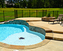 Custom Swimming Pool With Waterfall & Tanning Ledge