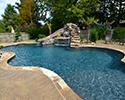 Freeform Custom Swimming Pool With Slide by Conway Pool Builders