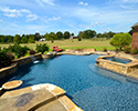 Custom Swimming Pool With Waterfall & Tanning Ledge | Vilonia