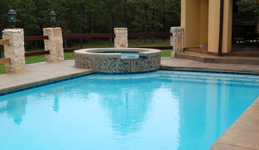 Rectangular custom pool with raised spa in Little Rock AR