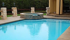 Rectangular custom pool with raised spa in Little Rock AR